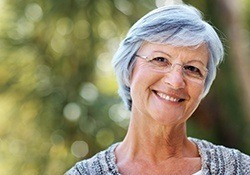 Smiling older woman outdoors