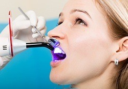 Woman receiving dental bonding treatment